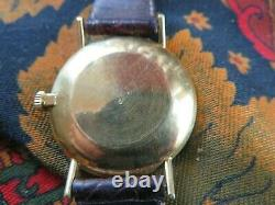 Ancienne montre bracelet homme TISSOT visodate en or massif automatique