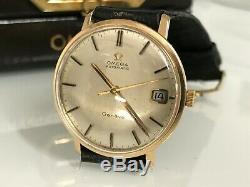 Montre Omega automatique Genève or 18 carat calibre 565