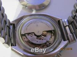 Rare Montre Chronographe Suisse automatique et quantième. TDBK 1369